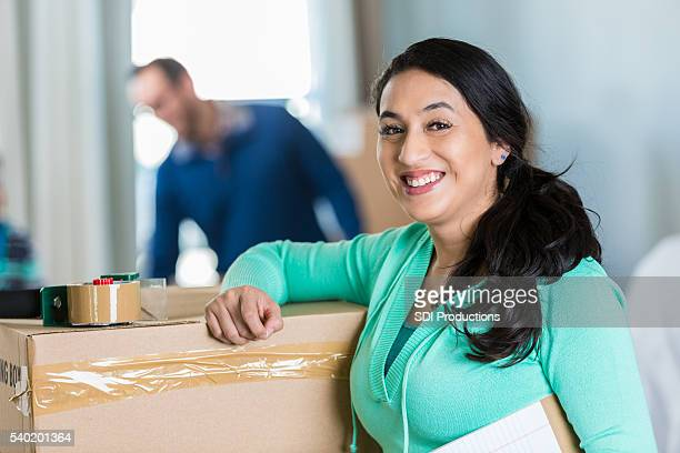 excited mom preparing to move to new home - belongings stock photos and pictures