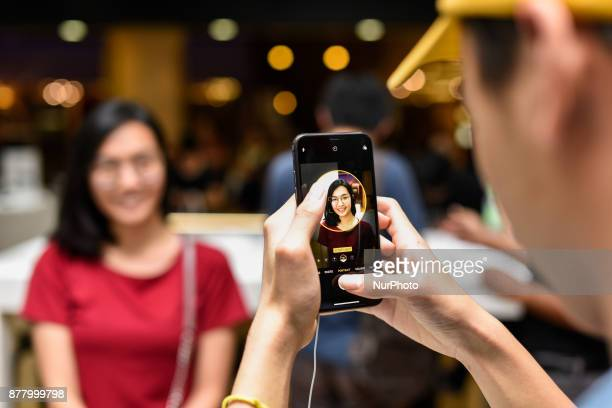 Excited newlyreleased iPhone X customers at Mac City Apple Reseller Store in One Utama shopping mall on November 24 2017 in Kuala Lumpur Malaysia