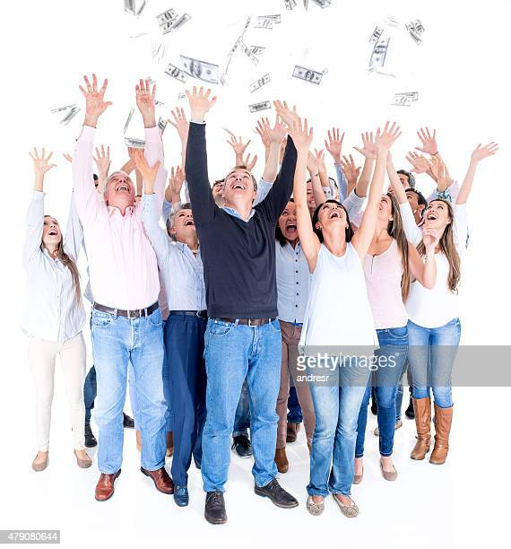 Excited people grabbing money