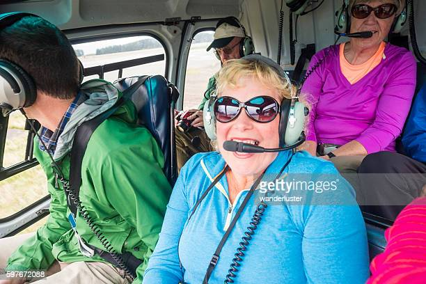 excited people on a helicopter - inside helicopter stock pictures, royalty-free photos & images