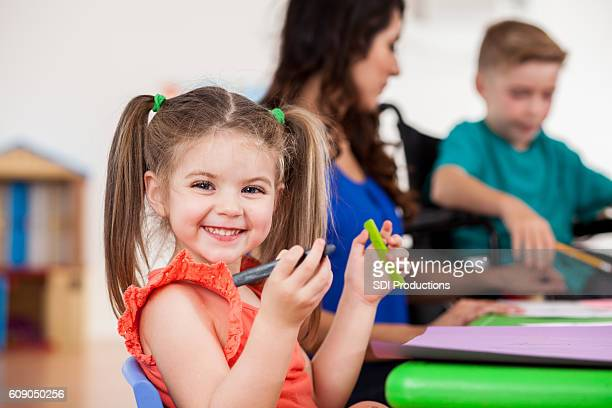 Excited preschool girl in class