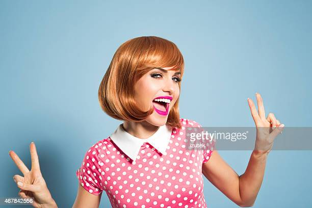 Excited red hair young woman wearing polka dot dress