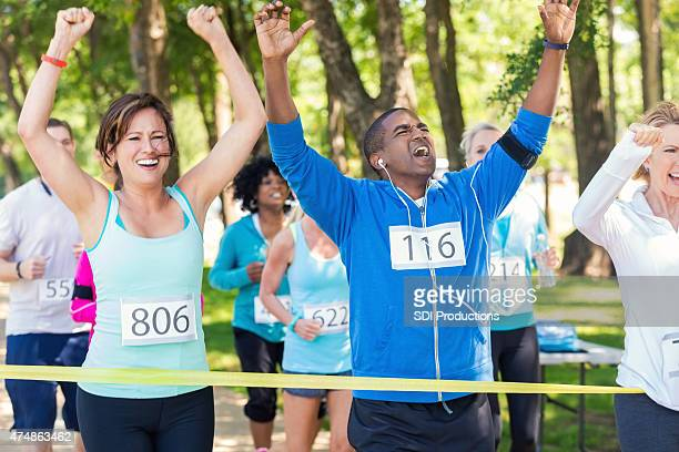 Excited runners celebrating as they win marathon or 5k race