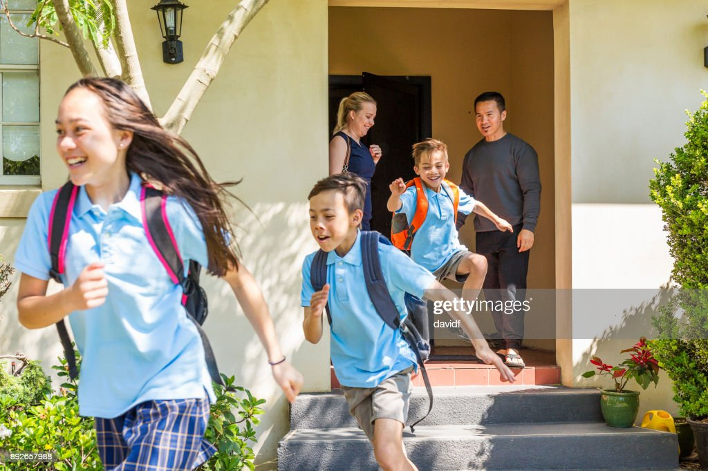 Excited School Children Leaving the House : Stock Photo