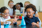Exited school girls during chemistry experiment