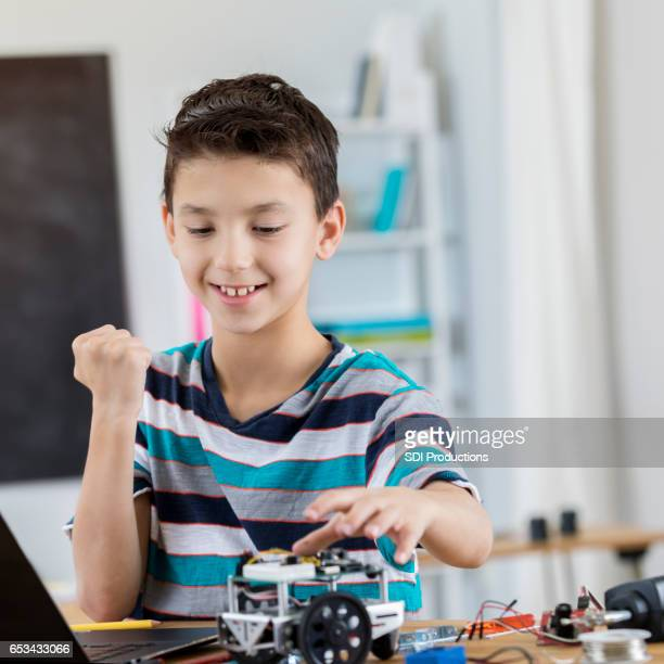 excited schoolboy finishes robot in science class - punching the air stock pictures, royalty-free photos & images