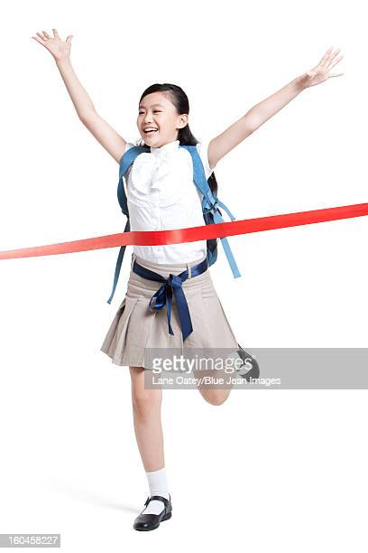 Excited schoolgirl sprinting to the finish line