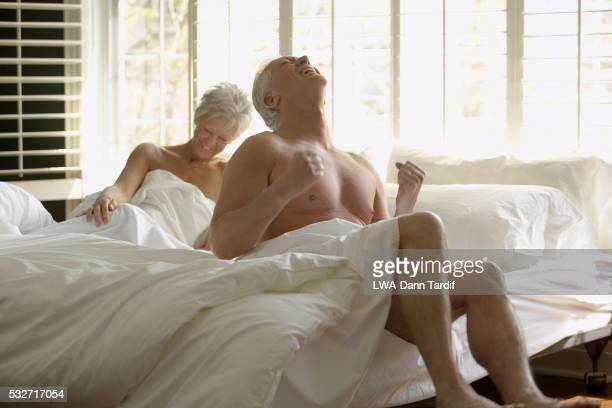 Excited Senior Couple in Bed
