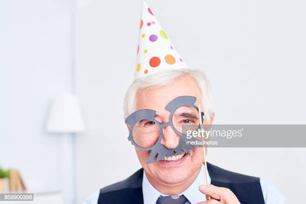 Excited senior in mask