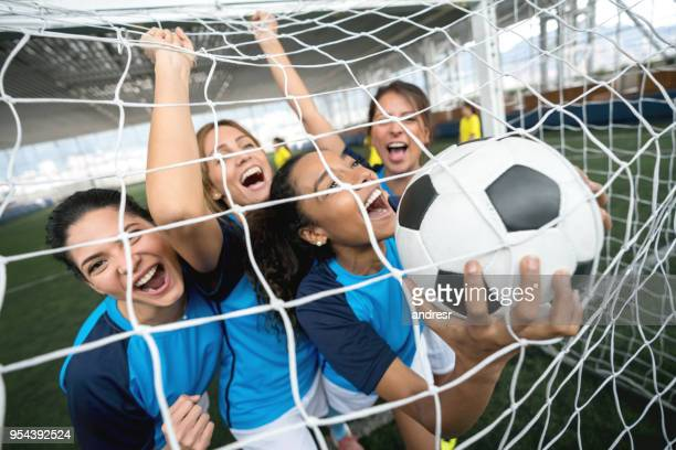 excited soccer players celebrating they scored a goal - soccer goal stock pictures, royalty-free photos & images