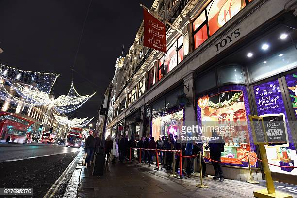 Excited Star Wars fans queue outside Hamleys for a first look at the new Propel Star Wars Battle Drones at Hamleys on December 2 2016 in London...