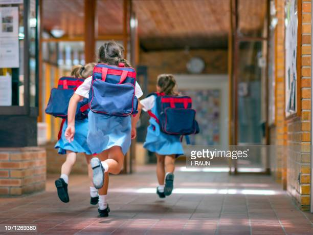 excited students running towards entrance - school children stock pictures, royalty-free photos & images