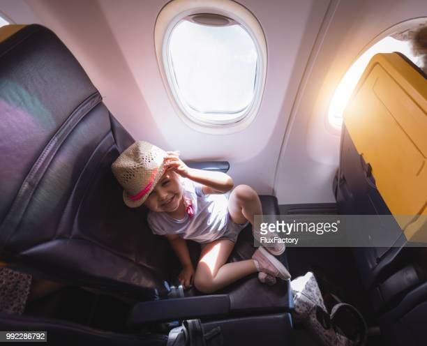 excited toddler sitting in a airplane - toddler at airport stock pictures, royalty-free photos & images