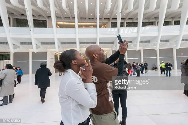 Excited visitors in the partially finished World Trade Center Transportation Hub, known as the Oculus, at its opening on Thursday, March 3, 2016. The...