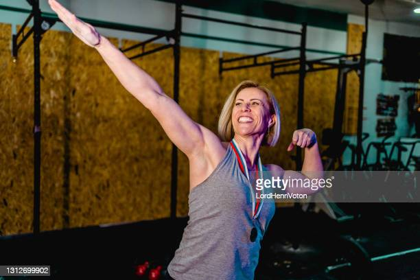 excited winner - medallist stock pictures, royalty-free photos & images