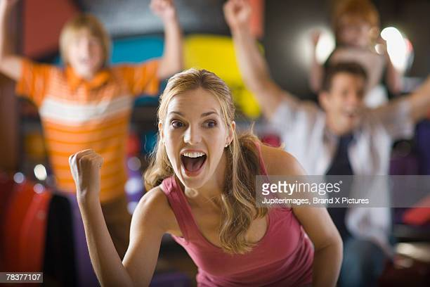 Excited woman at bowling alley