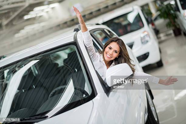 excited woman buying a car - motor show stock pictures, royalty-free photos & images