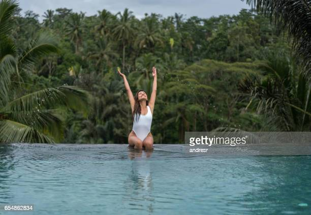 Excited woman enjoying her vacations in Bali