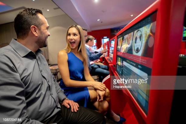 Excited woman expressing her surprise after winning at sports betting
