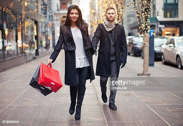 Excited woman going shopping with sad husband