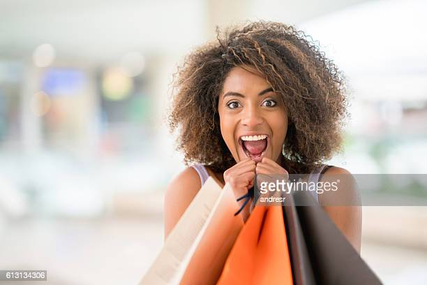 Excited woman having fun shopping