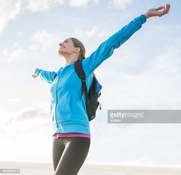 Excited woman hiking