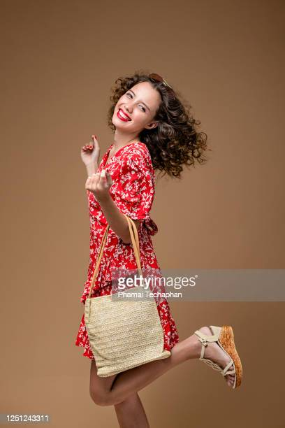 excited woman in red dress - hua hin thailand stock pictures, royalty-free photos & images