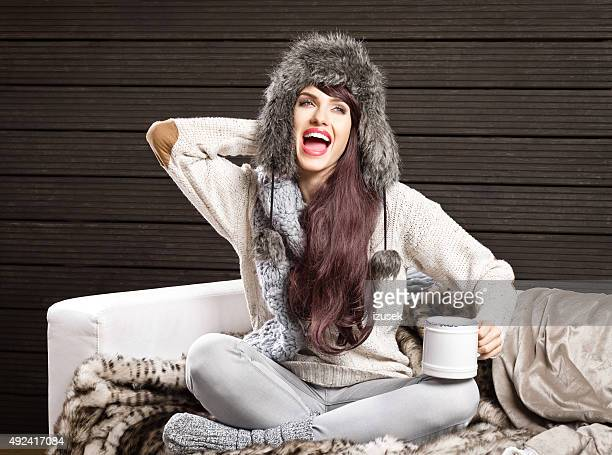 Excited woman in winter outfit wearing fur cap