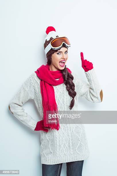 excited woman in winter outfit, wearing knitt cap and goggle - ski wear stock pictures, royalty-free photos & images