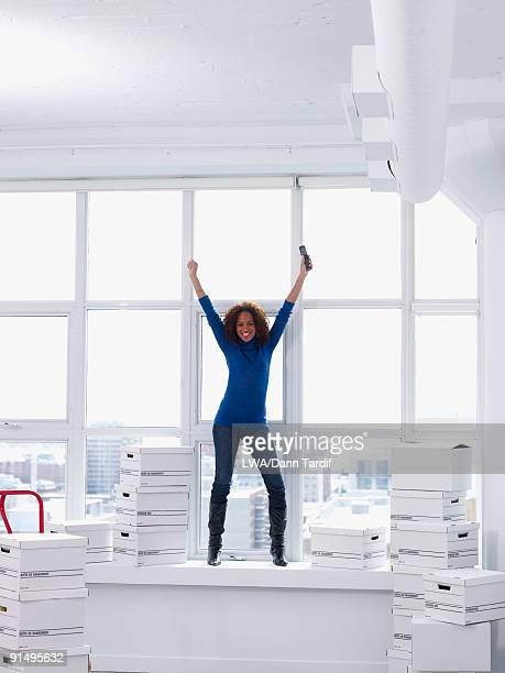 Excited woman moving into new office