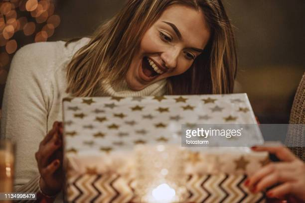 excited woman opening a present - birthday gift stock pictures, royalty-free photos & images