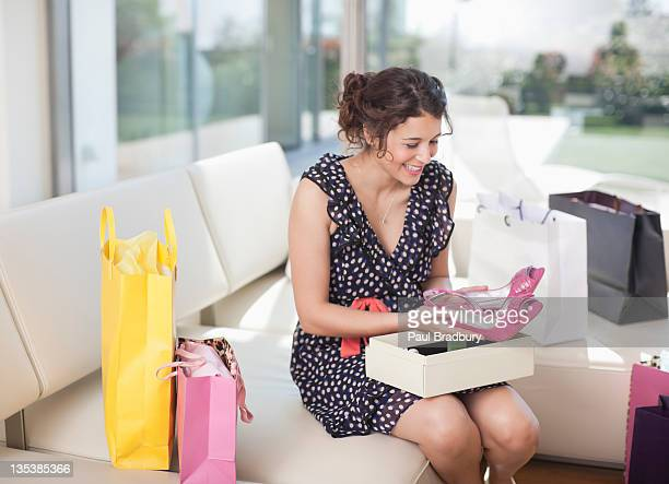 Excited woman taking shoes from box
