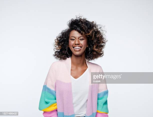 excited woman wearing rainbow cardigan - african ethnicity stock pictures, royalty-free photos & images