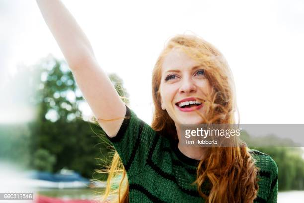 Excited woman with arm in the air