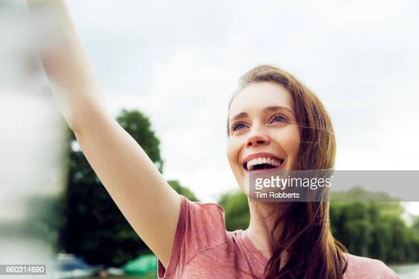 Excited woman with her arm in the air