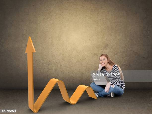 Excited woman with laptop and business graph