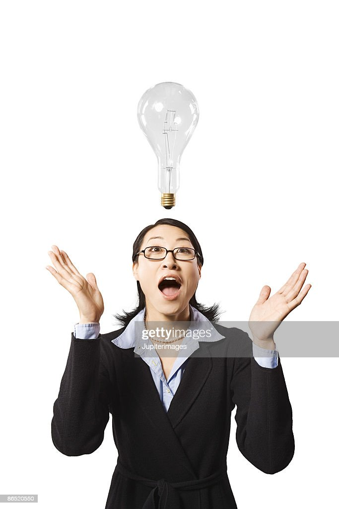 Excited woman with light bulb : Stock Photo