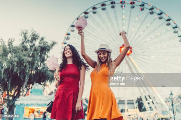 excited women at the amusement park - traveling carnival stock pictures, royalty-free photos & images