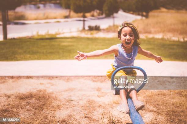 excited young asian girl having fun at the playground - biciancola foto e immagini stock