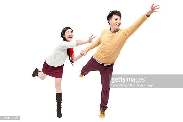 excited young couple in chinese new year - homem pegando mulher imagens e fotografias de stock
