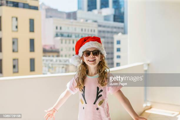 Excited young girl in santa hat