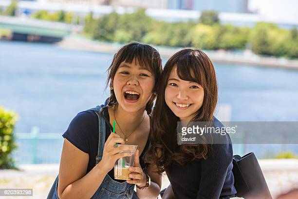 Excited Young Japanese Women Friends Enjoying a Drink