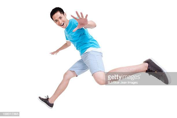 Excited young man running