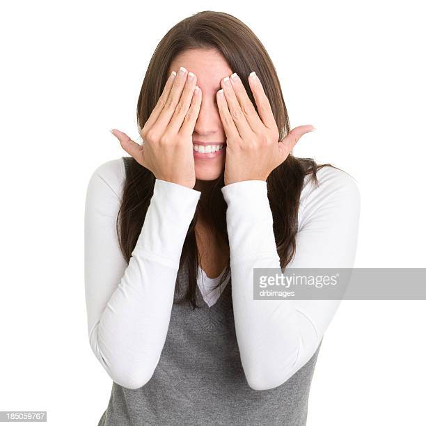 Excited Young Woman Covering Eyes