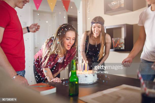 excited young woman gets birthday cake - happy birthday canada stock pictures, royalty-free photos & images
