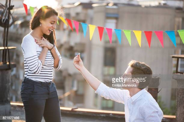 Excited young woman getting engaged