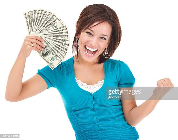 excited young woman holding money - bringing home the bacon stock photos and pictures