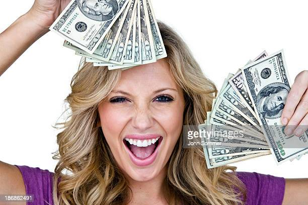 Excited young woman holding money