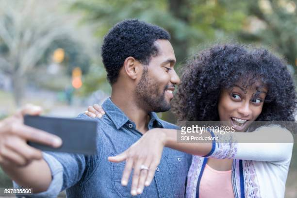 excited young woman shows off engagement ring - black women engagement rings stock pictures, royalty-free photos & images