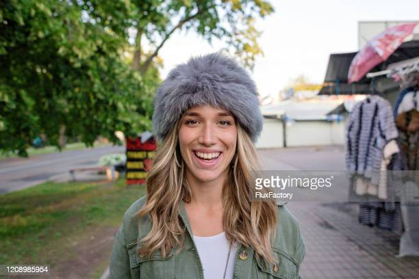 excited young woman wearing famous russian fur hat - fur hat stock pictures, royalty-free photos & images